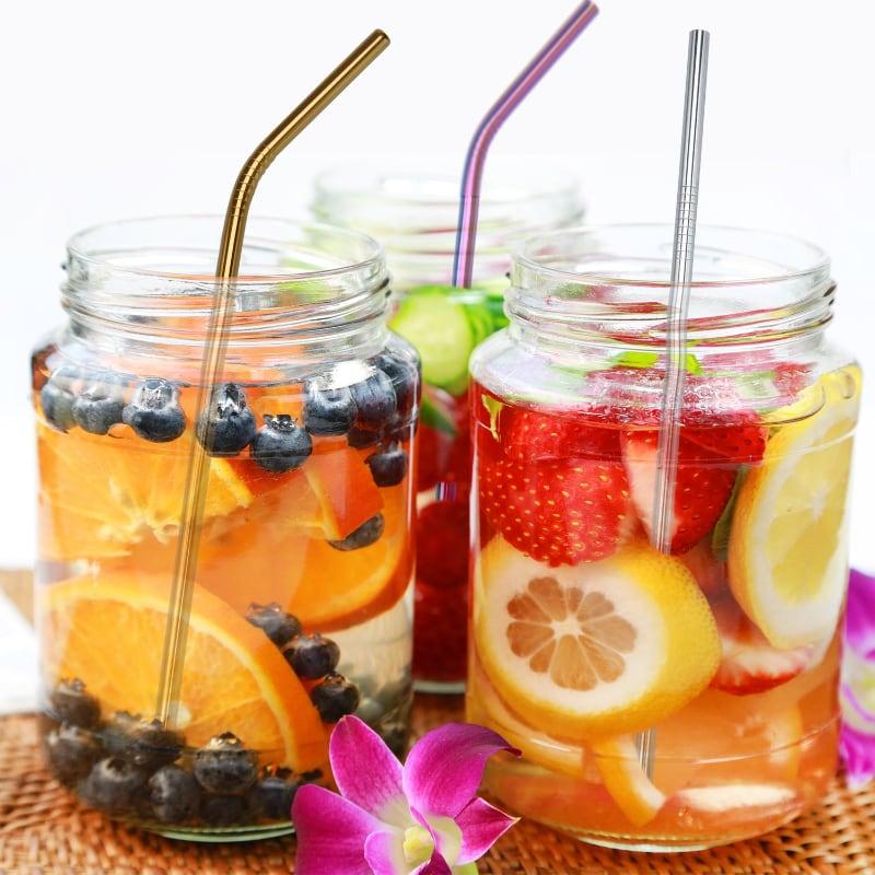 Produits inox : 3 Cocktails colorés avec des fruits frais coupés avec 3 pailles en inox